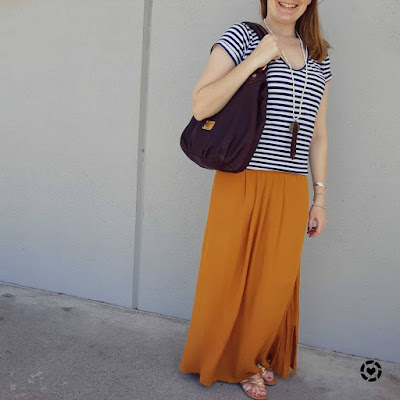 awayfromblue Instagram | spring mum outfit gold sandals MbMJ fran bag, ochre maxi skirt and striped tee