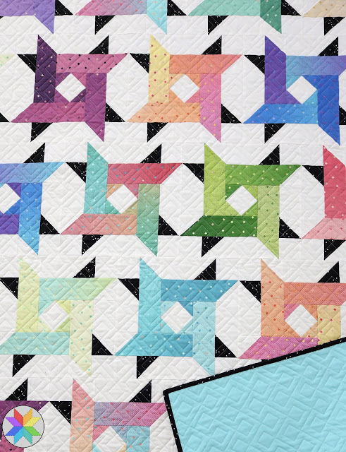 Windy City quilt pattern - perfect for using jelly roll strips and it looks great in ombre fabrics like Gem Stones Brights from Riley Blake Designs