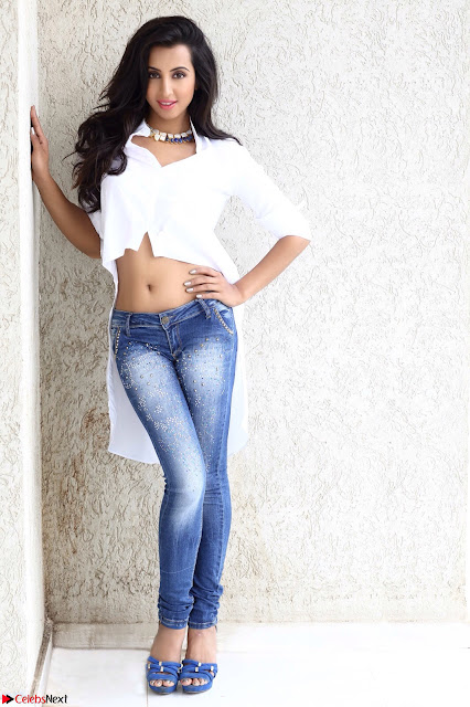 Sanjjanaa Galrani Looks Fabulous in Washed out Denim jeans and White Shirt (1).JPG