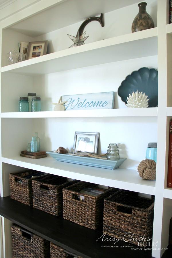 bookshelves with coastal decor