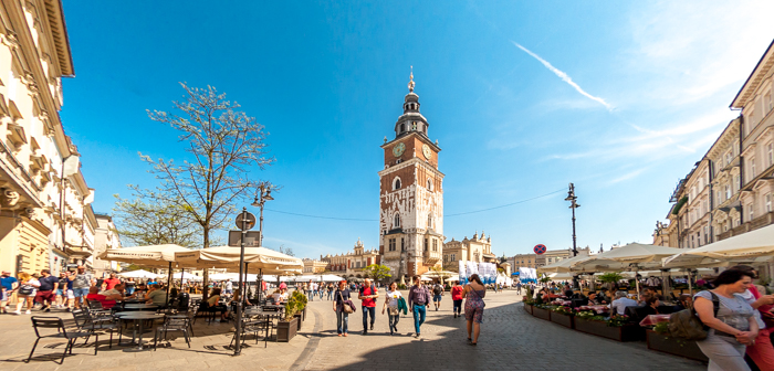 Standing high and distinctively in middle of main square of Krakow city, it's 70 meters high and built in 1300s. Over the time, it got impacted by various things but still in much better state in comparison to other historical buildings of Krakow city in Poland.     One can go inside and climb the 100 stone stairs to the top of Town Hall Tower of Krakow. The staircase is narrow, steep and spiral, like many such towers in different parts of the world. From the platform at the top of the tower, you can enjoy a spectacular view across Kraków city, especially the Main Square and Planty Park.