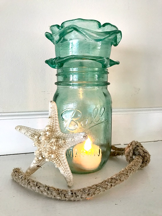 Blue frosted Mason Jar candle holder and starfish