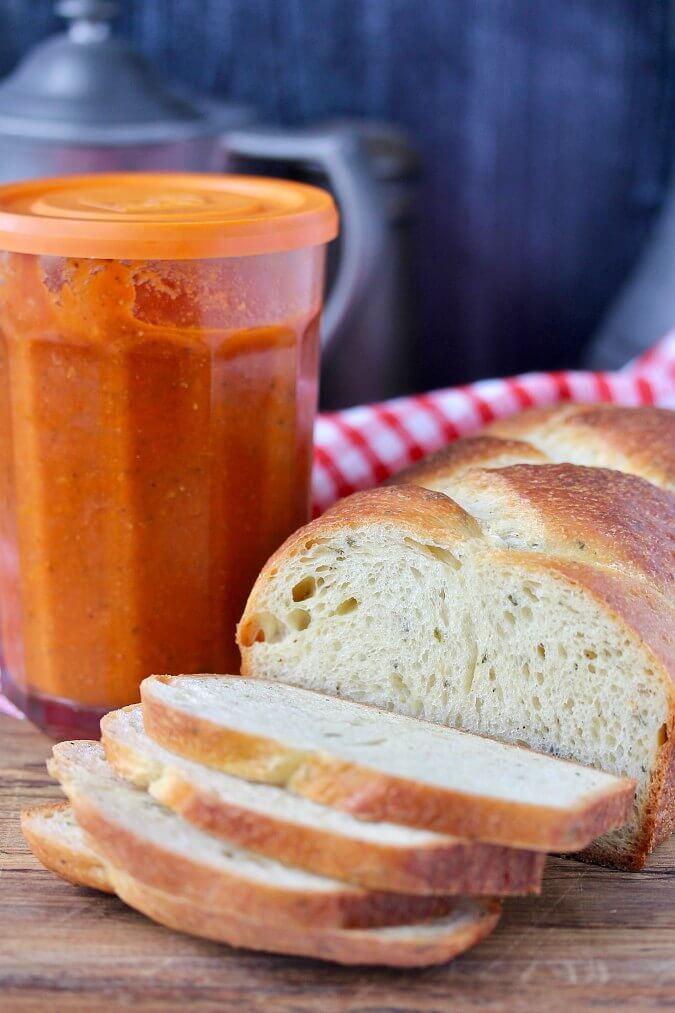 Crescia al formaggio bread sliced with tomato sauce