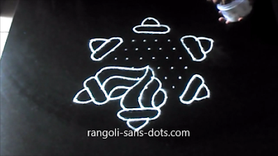 shankh-rangoli-with-dots-1211ad.jpg