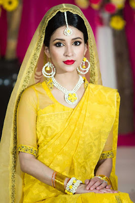 Beautiful Bengali Bride In Yellow Color Traditional Saree.