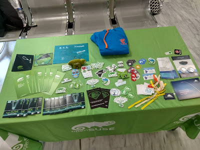 FOSSCOMM, openSUSE-GNOME-GNUHealth booth with promo materials