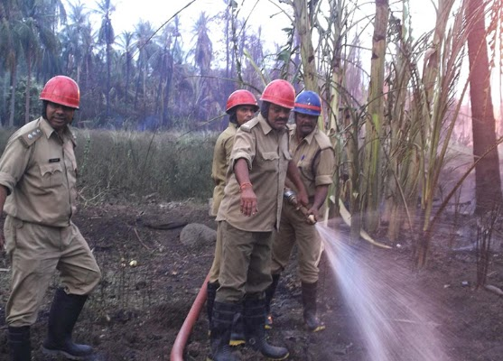 Firemen try hard to douse a fire that broke out after a blast in a gas pipeline belonging to GAIL in Andhra Pradesh's East Godavari district on June 27, 2014.