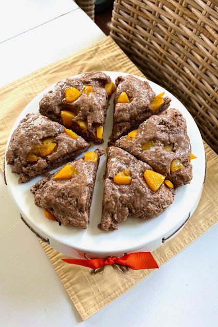 Dark brown scones with bits of peaches in them.