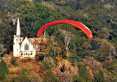paraglider flies above Kalimpong