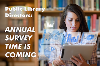 Photo of woman looking at graphs on tablet in library