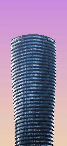 خلفية برج زجاجي حديث اسطواني الشكل