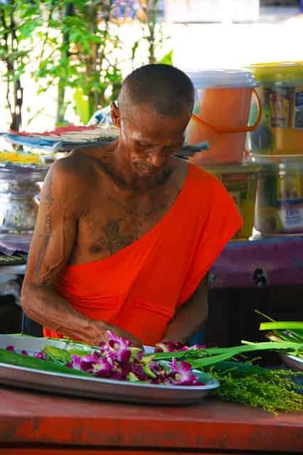 A monk wearing a tattoo
