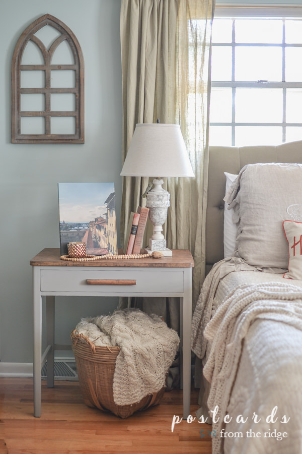 fall bedroom with cathedral window frame on wall
