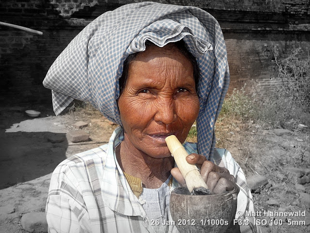 Burma, Myanmar, Bagan, old Burmese woman, people, street portrait, headshot, focal black and white, homemade Burmese cigar
