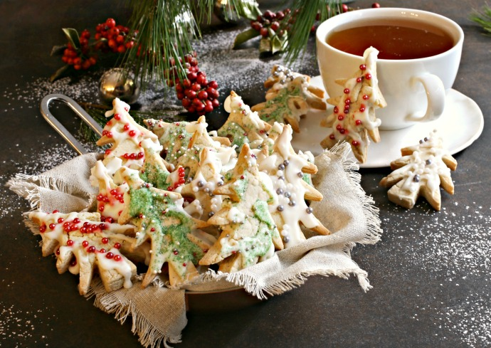 Recipe for shortbread cookies made with brown butter, frosted with white chocolate royal icing and sprinkles.