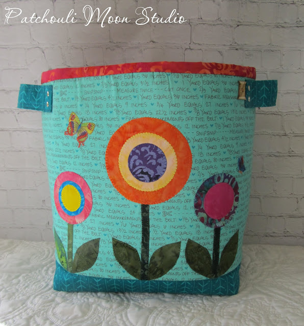 Back side view of Fabric container with handles and applique circle shaped flowers