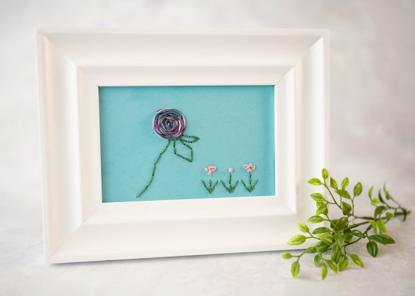 floral paper embroidery design in frame