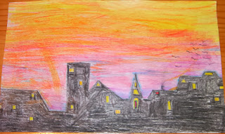coloured drawing of buildings and orange purple sky
