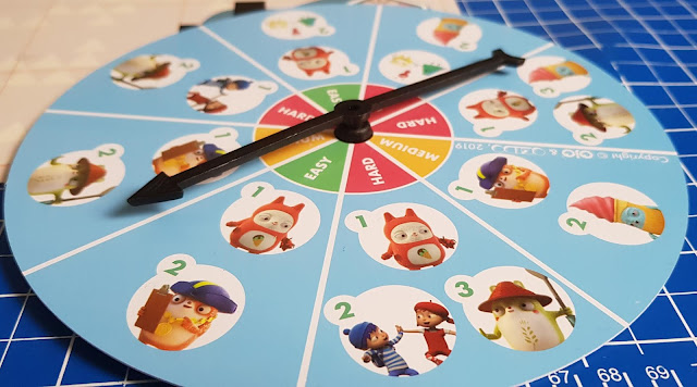 OKIDO Which Way Coding Game spinner showing segments with different pictures