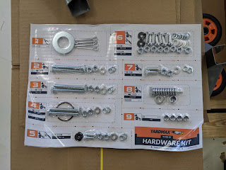 the kit has multiple nuts and bolts organized by when they will be used in assembly