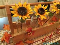 Use Dollar store finds and items from around the house to create a wooden toolbox centerpiece.