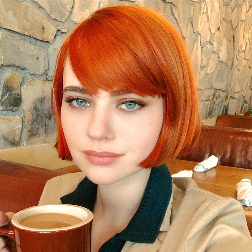 a portrait of a girl with short French haircut