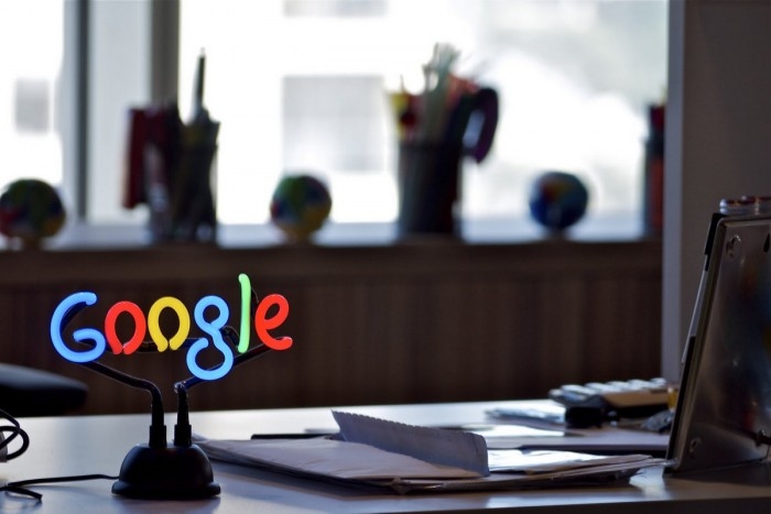 Picture of working desk with google logo