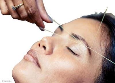 Cómo depilar el  vello de la cara con un hilo cruzado
