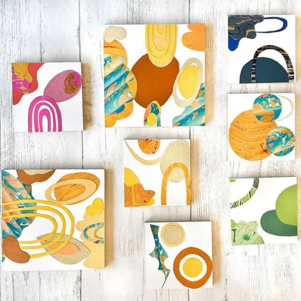 colorful paper collage squares hanging on wall