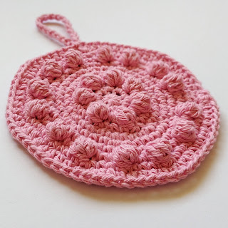 Pink crochet cotton dishcloth with blobbles.