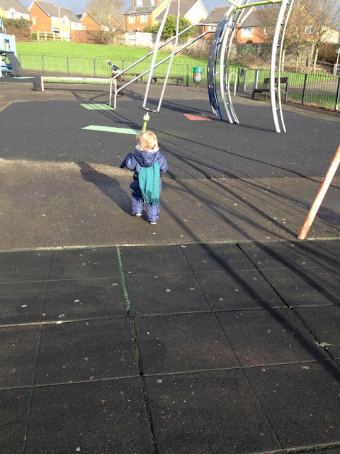Toddler running in park in the bright sunshine