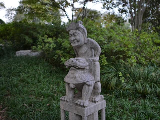 Chinese sculpture of a person riding a lion