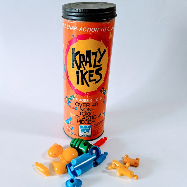 image of vintage game in cardboard tube and plastic pieces
