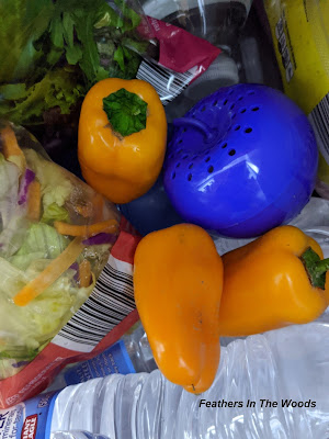 Blue apple in refrigerator with produce