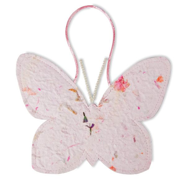 handmade paper containing flower petals made into a stitched butterfly sachet