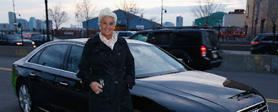 Koren Grieveson's partner Anne pose for a photo with her car