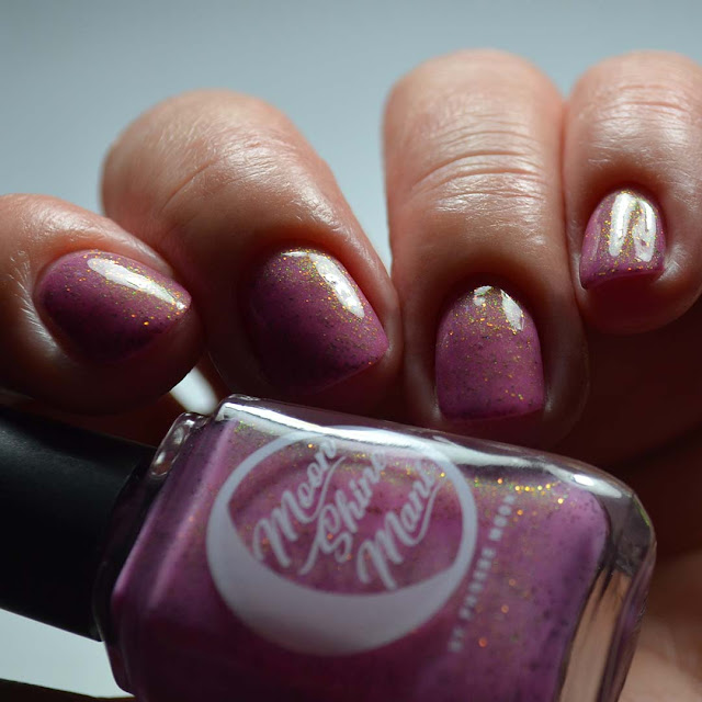mauve nail polish with shimmer low light swatch