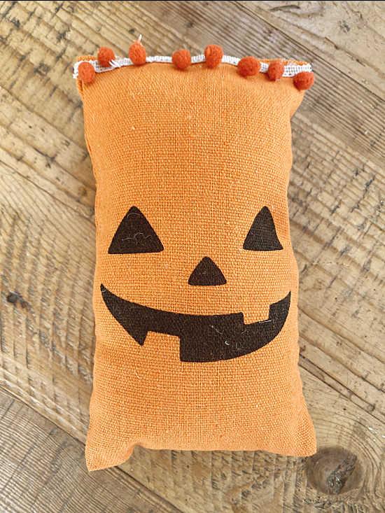 pumpkin bag with pom poms