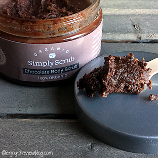 open jar of Simply Scrub Organic Chocolate Body Scrub on a wooden table