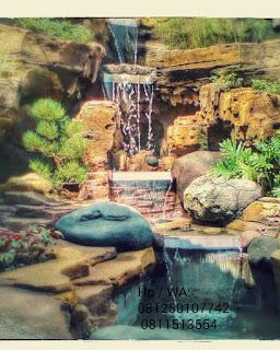 Dekorasi air mancur dan kolam koi