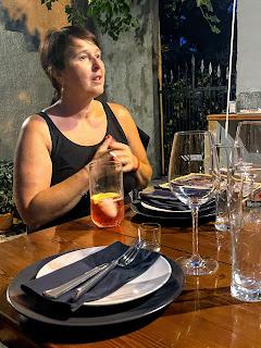Woman, Marija Papak, talking at a dinner table