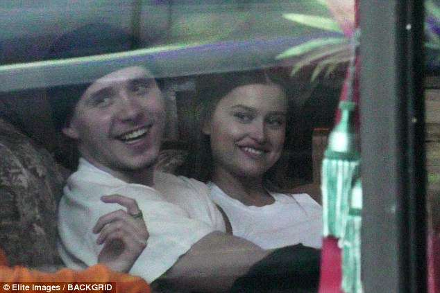 Brooklyn Beckham splits with Chloe Moretz: Teen is spotted passionately kissing Playboy model Lexi Wood in West Hollywood tattoo parlor