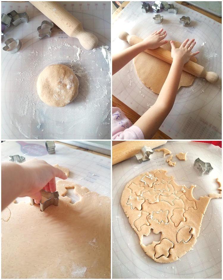 Cortando la masa con cortadores de galletas de animalitos