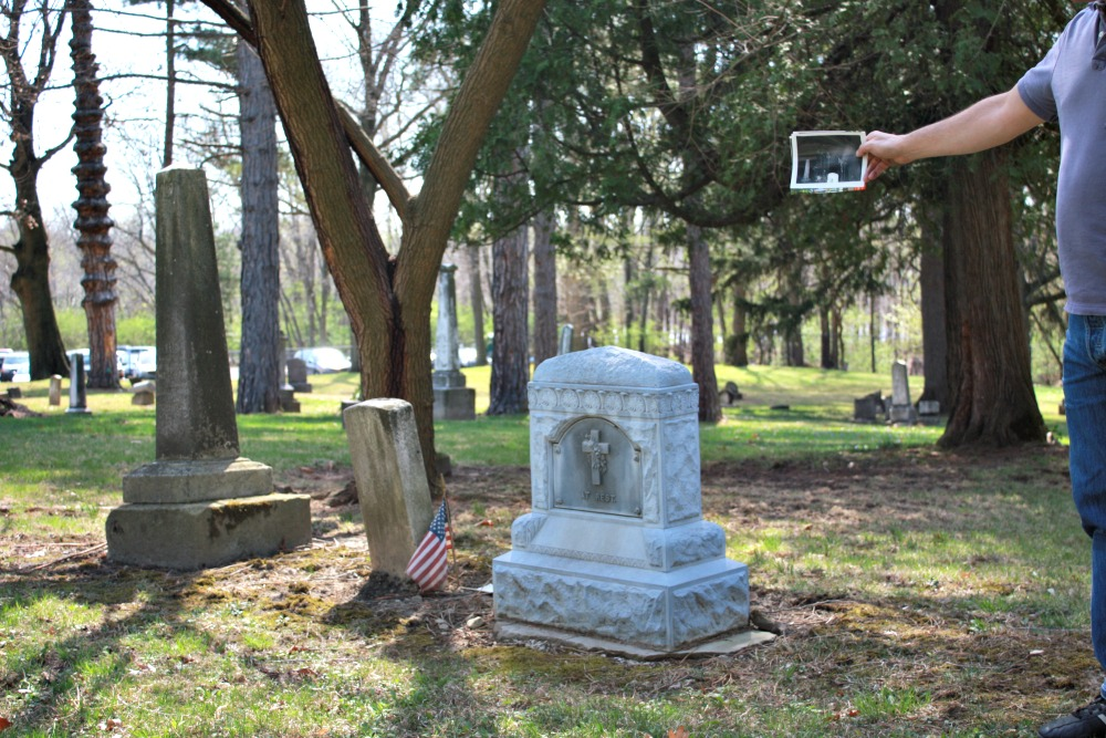 Original ghost photo next to gravestones