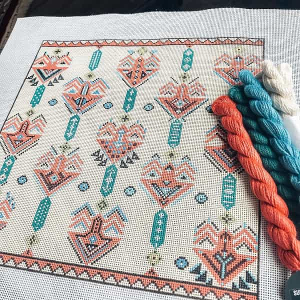 Tribal geometric pattern in coral and greens needlepoint canvas