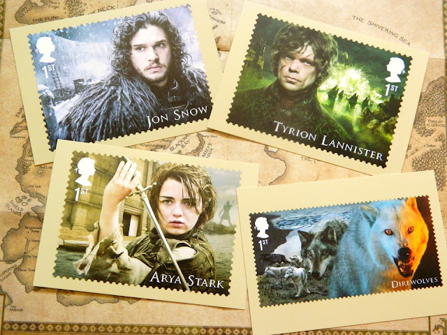 A photo showing a set of four Game of Thrones stamp postcards