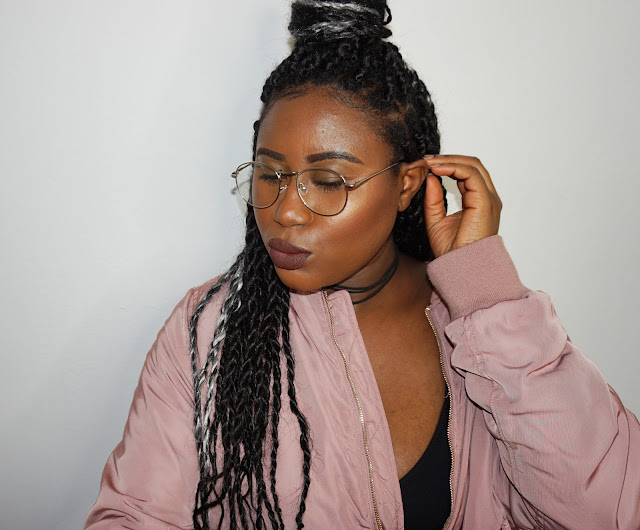 grey braids, grey braids hairstyles, brown lipstick, pink bomber jacket