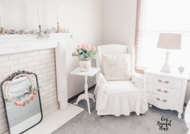 white bedroom chair bedside table