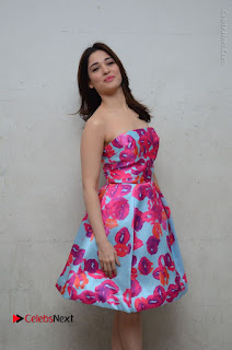 Actress Tamanna Latest Images in Floral Short Dress at Okkadochadu Movie Promotions  0080.JPG