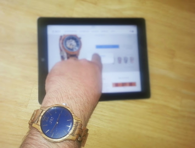Jord watch on man's wrist using ipad